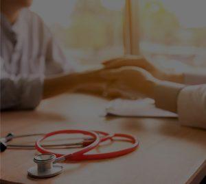 medical professional holding hands